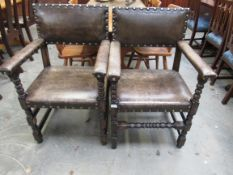 Two leather Jacobean style carver chairs,