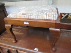 An Edwardian mahogany footstool with drop-in seat,