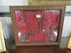 A wall hanging display case of assorted 18th and 19th iron keys