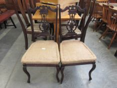 A pair of late 19th Century mahogany dining chairs,