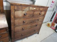 A George III flame mahogany chest of two secret drawers over two short and three long on outswept