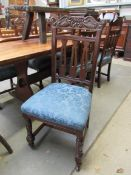 Six late Victorian mahogany dining chairs with dolphin carved backs