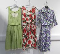 Two 1950's day dresses and a lilac and green fruit pattern dress jacket ensemble