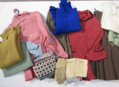 A box containing mainly 1940's and 1950's ladies clothing including knitwear, skirts, pajamas,