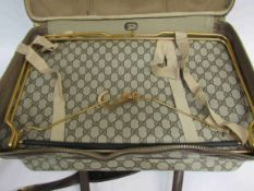 GUCCI Vintage 1970's soft body luggage case. brown canvas body with GG monogram.