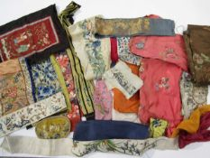 A small quantity of mainly Chinese silk embroideries, possibly late 19th/early 20th Century.
