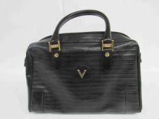 VALENTINO black leather soft body handbag.