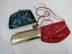 A Kurt Geiger red and white leather shoulder bag, with another,