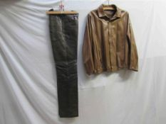 A pair of Georgio Armani dark brown leather trousers and a Loewe buff coloured sumptuous leather