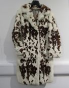 A 1960's white fur coat with a brown mottled spot pattern,
