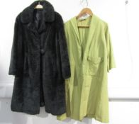 A 1960's grey faux fur coat with a large bobble button cross over fastening and a 1950's pale green