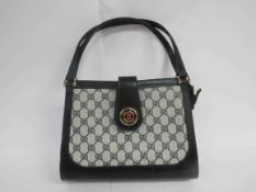 GUCCI BREVETTATO GG vintage monogram double handle handbag.