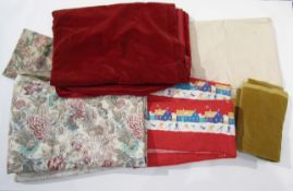 A box containing a quantity of upholstery and curtain fabric including velvet,