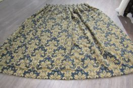 A blue and stone repeated flock pattern door curtain, lined,