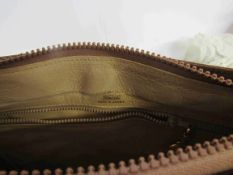 GUCCI 1970's brown velvety suede shoulder bag which is perfectly sized.