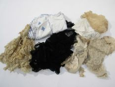A bag containing a quantity of various lace
