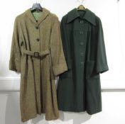 A dark green wool coat with a large collar, turn back cuffs, seamed yolk,