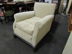 A late Victorian armchair with ball and claw feet,