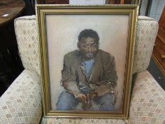 An oil on board portrait of a seated man, unsigned, framed,