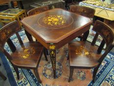 An Italian Indian rosewood games table with marquetry floral inlay.