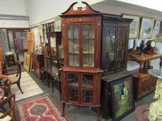 An Edwardian Art Nouveau influenced corner cabinet with brass inlay,
