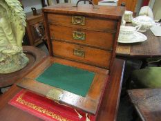 An early 20th Century stained pine three drawer engineer's chest with lockable front