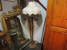A gilded standard lamp with shade