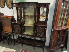 An Edwardian glazed display sideboard with high relief acanthus detail (central door locked) 175cm