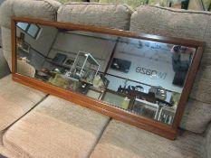 An oak overmantel mirror,