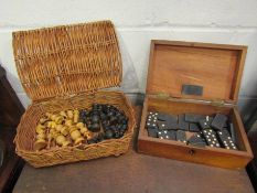 A turned hardwood chess set and domino set