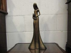 A resin bronze figure of mother and child,