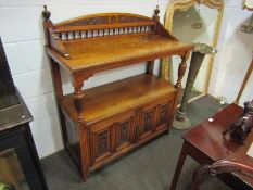 A Victorian walnut two tier serving table/buffet with raised gallery back,