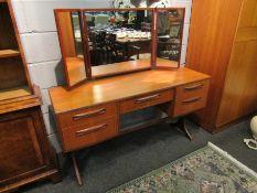 A G-Plan teak dressing table with three fold mirror