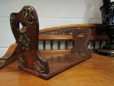 A Victorian walnut bookstand with brass scrolled mounts