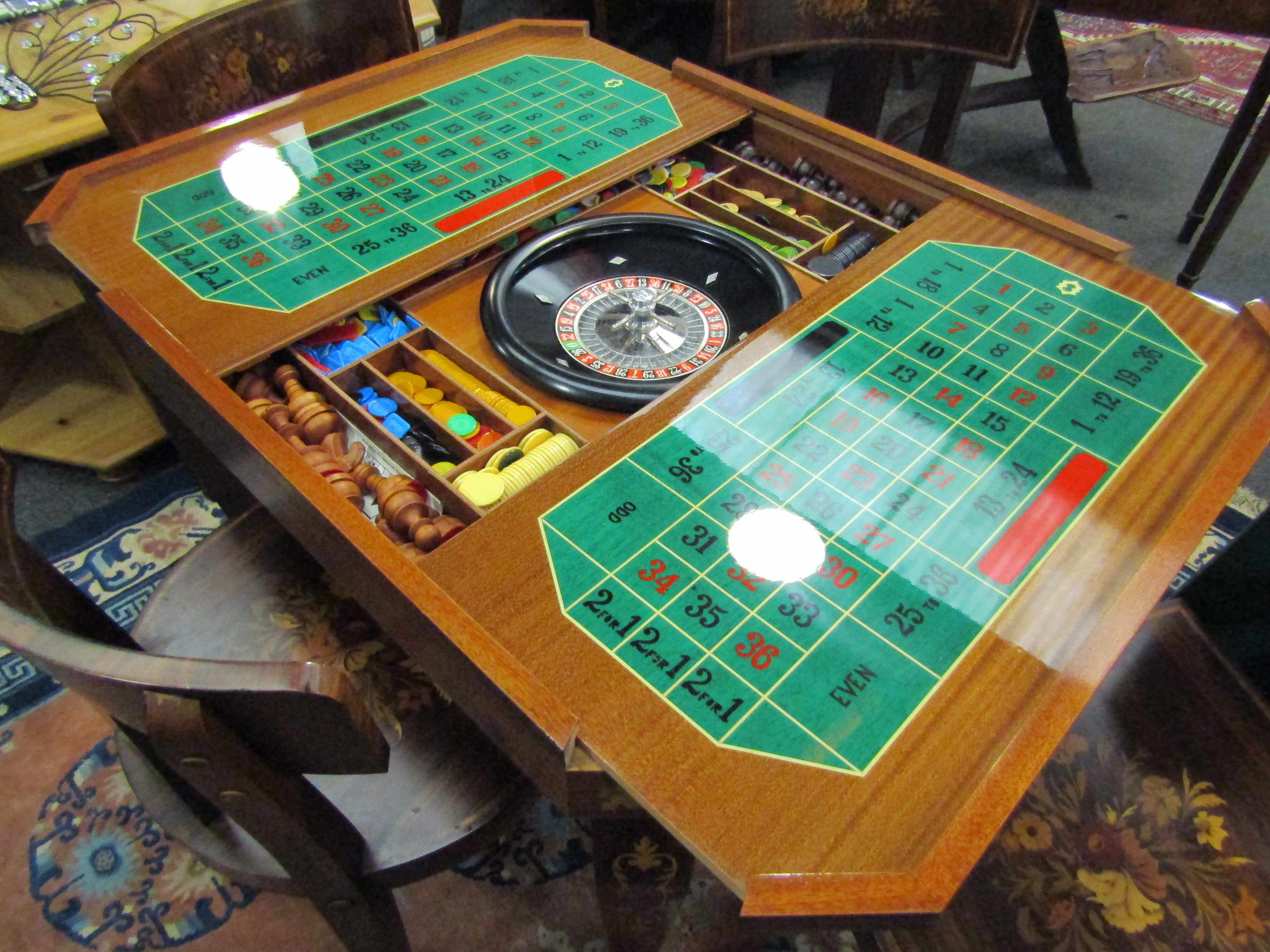 An Italian Indian rosewood games table with marquetry floral inlay. - Image 2 of 6