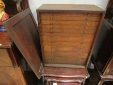 An early 20th Century oak engineer's/specimen cabinet with eleven graduating drawers and front