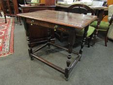 An early 19th Century oak side table, turned supports,