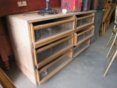 A six drawer fitted shop unit with glazed fronted drawers 130w x 47d x 70h cm