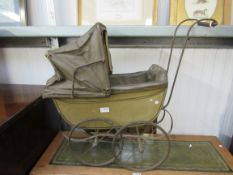 A Victorian child's pram with original paint