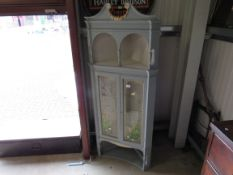 An Edwardian mahogany corner cabinet with hand painted glass doors with flowers and bees