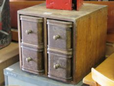 A 1930's oak bank of four drawers,