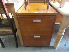 A 1970's teak two drawer filing cabinet