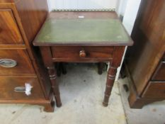 A small Georgian mahogany desk with green leather top and gilt brass gallery over a single drawer