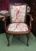 "An Edwardian ladies elbow chair, the scroll arms over cabriole legs and turned ""H"" stretcher,"