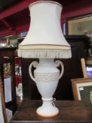A ceramic twin handled table lamp with shade