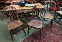 Five similar late 19th Century elm seated stick back chairs with V-support to backs and 'H'