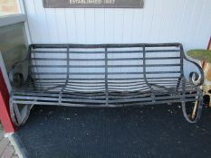 A 19th Century strap iron four seater bench,
