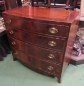 An early Victorian crossbanded mahogany bow front chest of four graduating long drawers with brass
