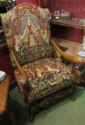 An 18th Century style carved walnut open armchair with acanthus leaf scroll arms and upholstery