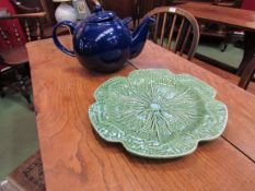 A large blue London Pottery teapot and cabbage serving plate